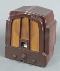 """Lot No 217 A stylish art deco Ecko radio No.SB03664 contained in a brown Bakelite case 16""""h x 15""""w x 10""""d, sold for £150"""