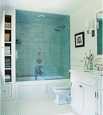 Pretty blue glass tile in shower and clever storage idea for Blue tile bathroom ideas