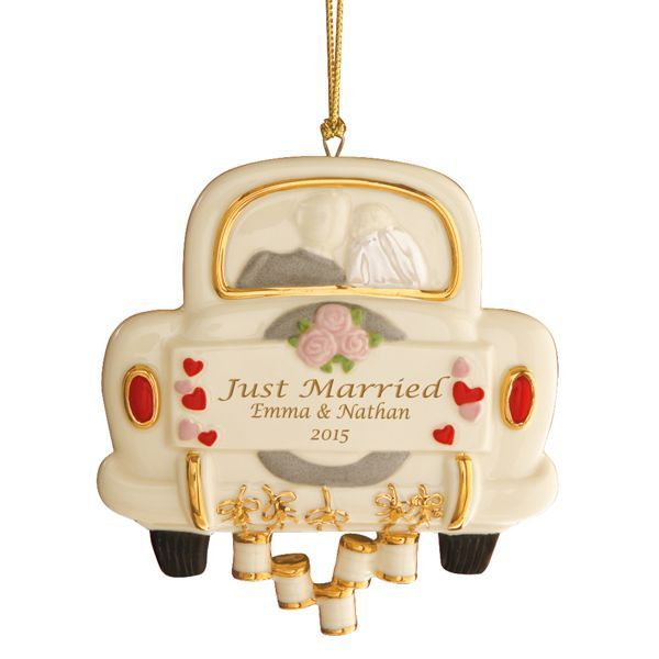 """Off go the """"Just Married"""" couple with tin cans trailing behind their car. This lighthearted ornament is a gift the newlyweds will cherish for Christmases to come. Personalize with 2 names up to 12 characters each and year. Crafted of hand-painted Lenox ivory fine china accented with 24 karat gold. Includes golden hanging cord. Personalized items require extra time. Please allow 5-7 days for this item to be personalized."""