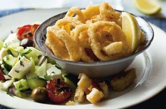 Deep-fried squid with Greek salad - Woman's Weekly