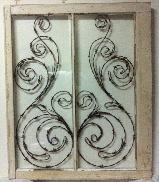 i could totally do this with one of my windows.  I just need to find some barb wire I can upcycle.