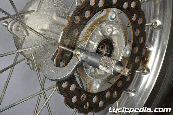 Kawasaki KLX140 rear brake disc inspection thickness runout replacement torque specs http://www.cyclepedia.com/online-manuals/kawasaki-atv-motorcycle-online-manuals/2008-2011-kawasaki-klx140-motorcycle-online-manual/