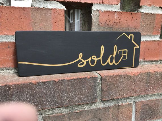 Wood sign - Realtor Sign - Small shelf sitter - photo prop You can have this sign : Black matte with gold metallic or Black matte with Silver metallic Realtor Sold Sign with a house on it. This wood sign is 3.5 x 11 inches and perfect for the Realtor to have their new home buyers for a