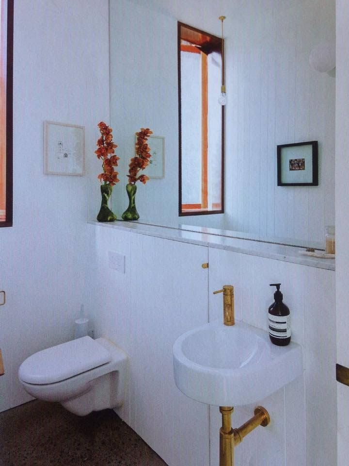 Bathroom 'ledge' with wall mounted basin and toilet