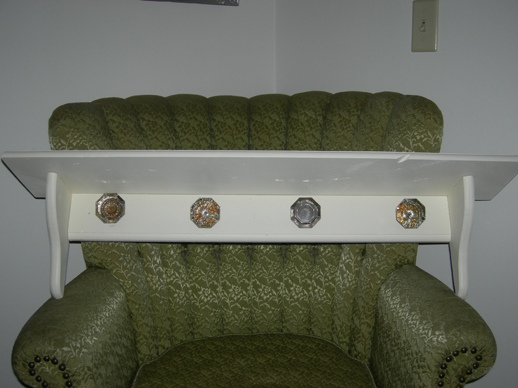 colored glass door knobs. ignore the chair but i want to make a wooden shelf with antique glass door knobs as hooks like this one colored