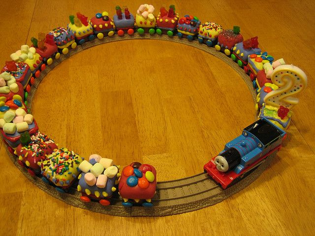 .. cupcakes .. will do full size w/ regular frosting, but I love the idea of the track, the real train, and the 2!