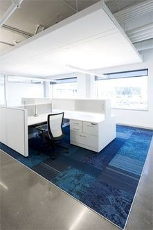 The white workstations, tables and task seating with flashes of the corporate color create an inspiring environment for all employees.