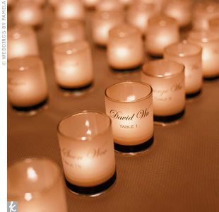 Escort Cards Table Idea: Great idea for a winter wedding. Lets people know where to sit as well as favours.
