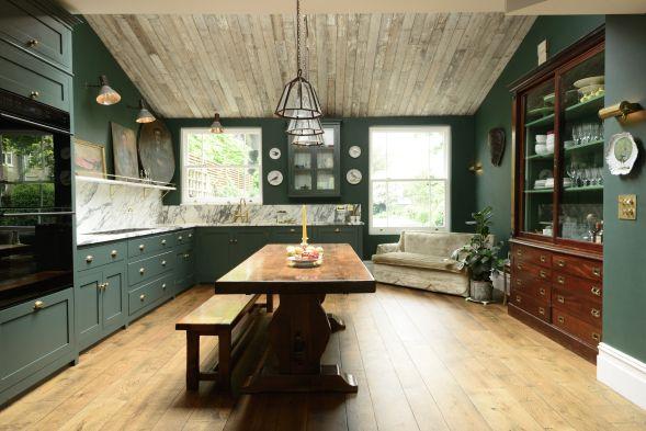 Green shaker Peckham Rye kitchen with marble splashback by deVOL Kitchens