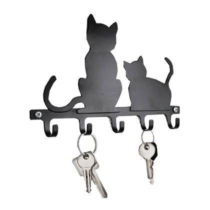 Decoratief sleutelrek in de vorm van twee katten.