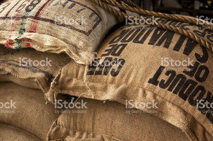 Burlap sacks with coffee beans royalty free stockfoto