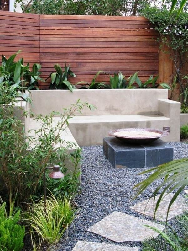 seating inset into raised beds with timber screen / fence