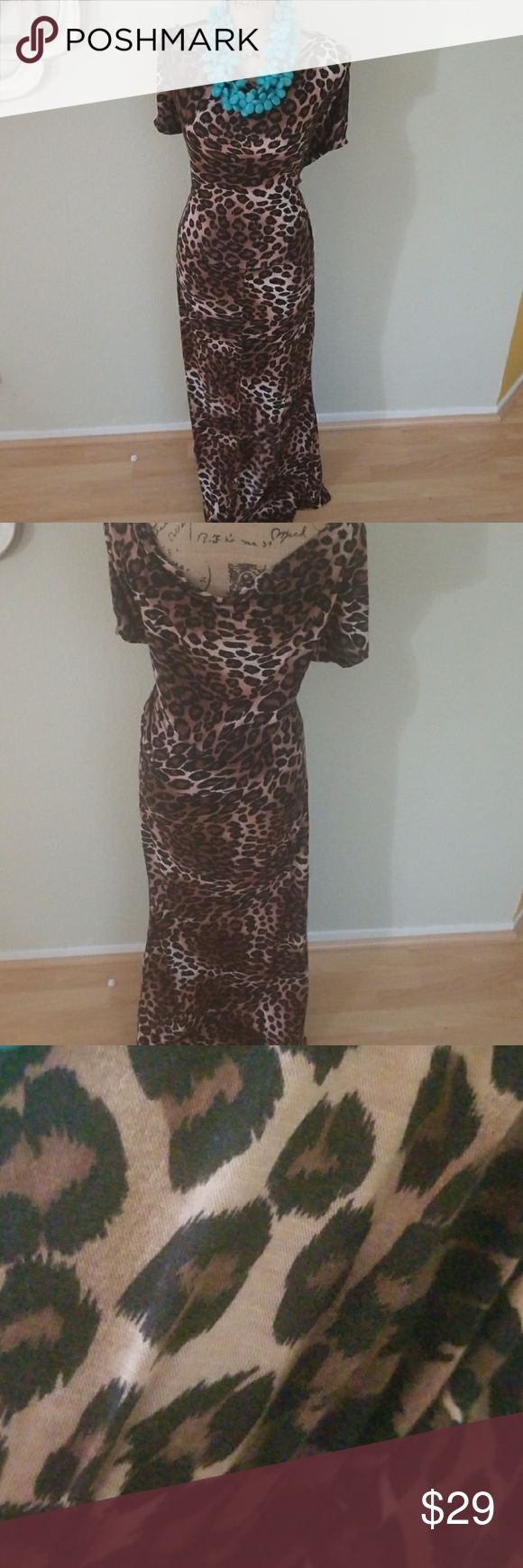 Animal print dress..ohh so much Fun Animal print dress..ohh so much Fun Wonderfully flexible enough to be worn low on the shoulders, low in front and back and with Just about any color shoes...Command presence! Dresses Maxi