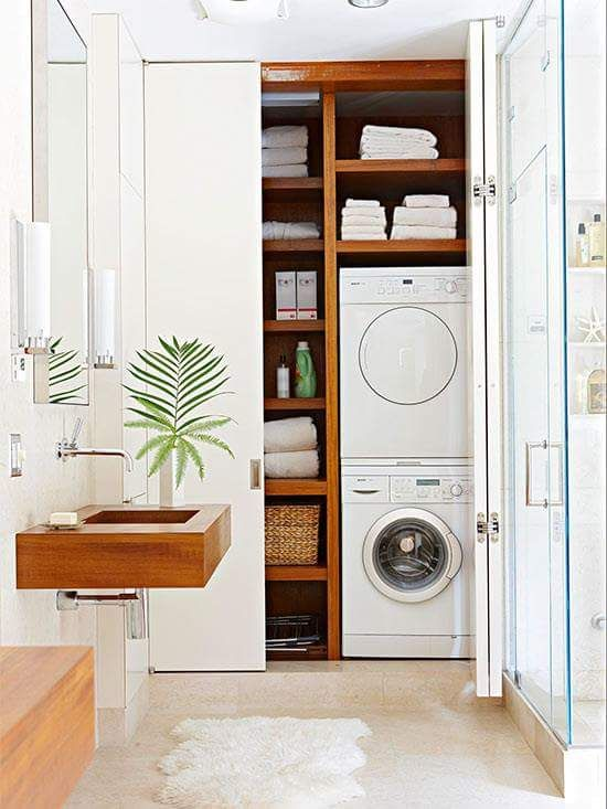 Small laundry in bathroom.  Especially love the timber and the stackable washer/dryer