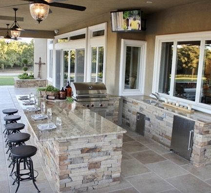 Perfect Outdoor kitchen with kitchen pass through at michaelglassman.com