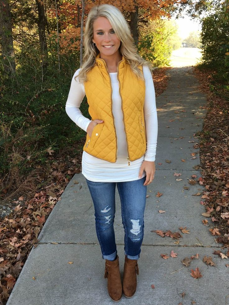 Say Hello to the perfect completer piece. We love how versatile this quilted vest is; the outfit possibilities are endless. Featuring a sturdy zipper in gold, zippered pockets, quilted bodice with kni