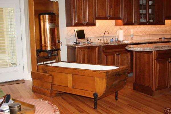 A folding bath tub!  This tub was made by the Mosely Company, out of Chicago in the 1880's. It has a ten gallon copper tank, heated by a small kerosene burner ~ what's old is new again!