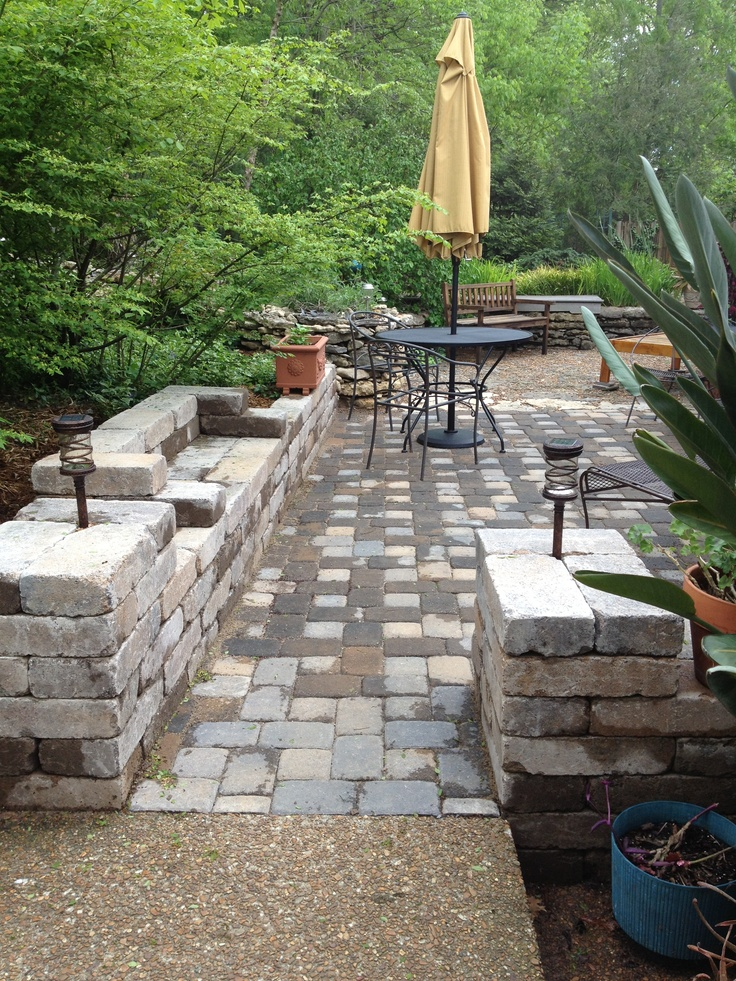 Outdoor sitting area - use the pavers and build UP into seating around the walkway