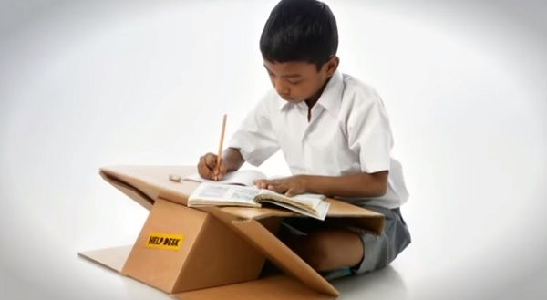 Help desk made from recycled cartons transforms into school bag for children in developing countries.