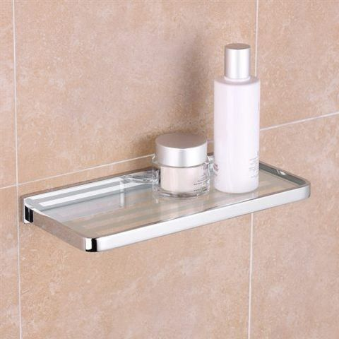 A simple little shelf can help keep things clutter-free in your bathoom. http://www.bathroomheaven.com/chrome-bathroom-accessories/brass-shelf(size300mm-solid-brass-chrome-15320.aspx