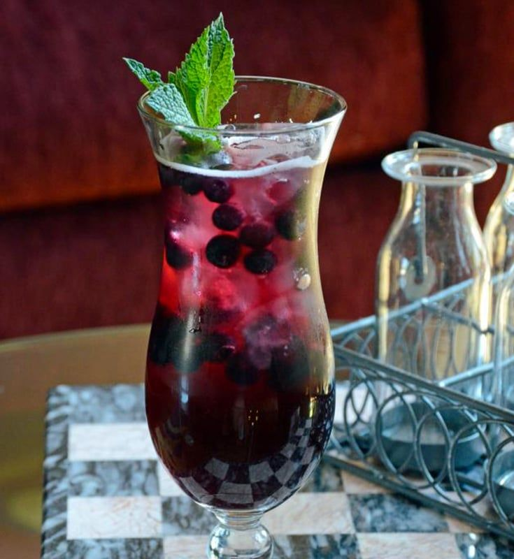 This Blueberry Pomegranate Sangria made with delicious pomegranate juice, blueberries, Barefoot Red Moscato and a mint garnish is the perfect mix of refreshing and fruity.