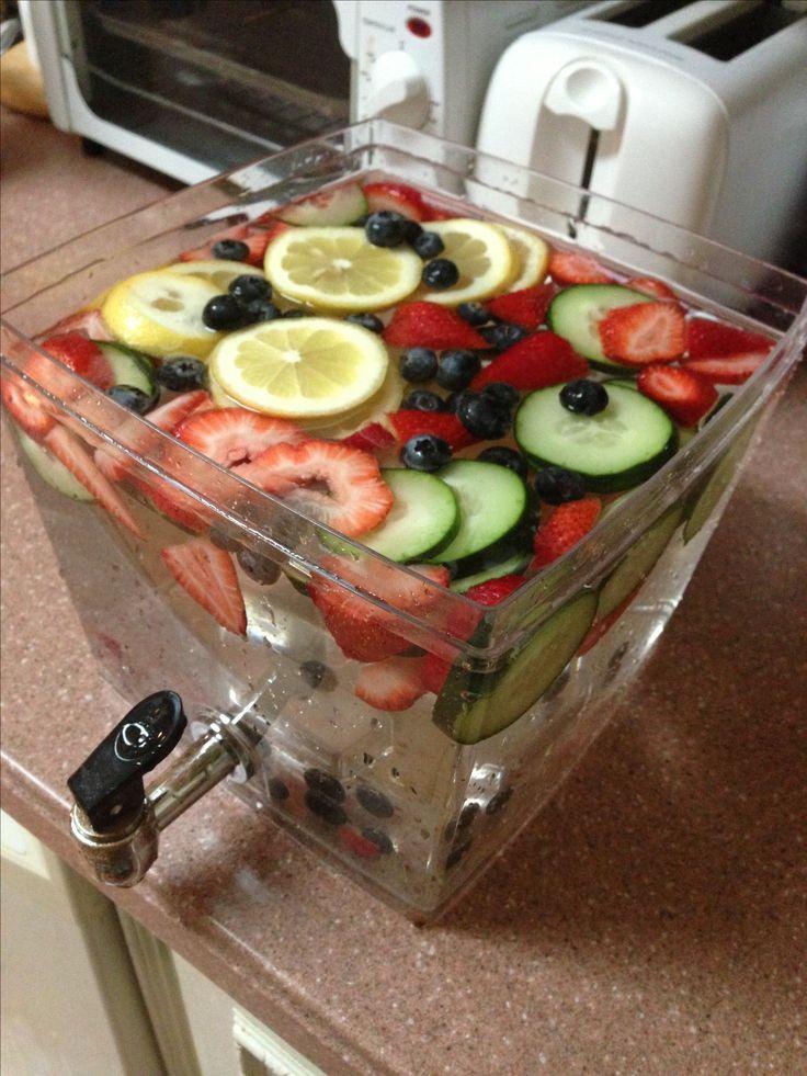 Detox water - lemon, cucumber, strawberries, and blueberries