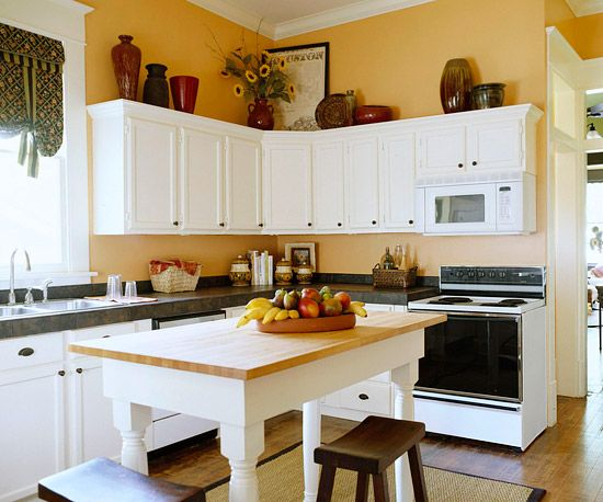 Cozy Family Kitchen Budget-Friendly Alternatives - the decorative display of pots and baskets enhances the dead space above the cabinets