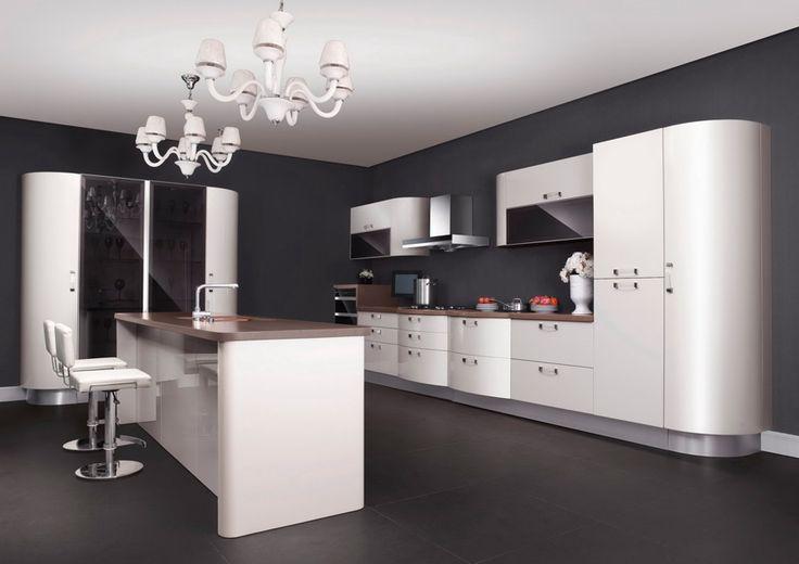 Casabella | Cocina tubular blanca con gabinetes de vidrios ahumados. Encuéntralo en: Casabella, Calle 109 Nº 14B–16 · Teléfono: +57 1 466 0015 · Bogotá, Colombia