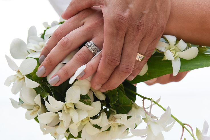 Wedding rings on Fiji bouquet with frangipani white flowers by Anais photography