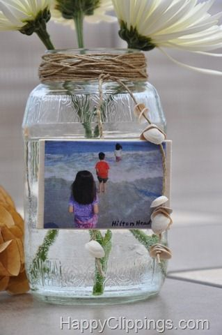 Another sweet beach memory jar to add to the collection here: http://www.completely-coastal.com/2011/07/photo-display-ideas-for-beach-memory.html