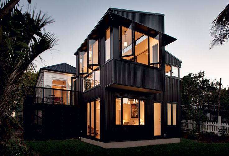 This modern, corrugate-clad addition by Scarlet Architects sits behind a traditional villa.
