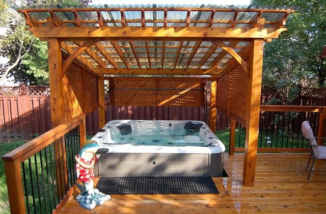 Clear Corrugated Roof Panels Give Us a Clear View to the Sky: Attractive Covered Spa Which Incorporated Into The Cedar Deck In Backyard With Clear Corrugated Roof Panels And Outdoor Hot Tub Plus Pergola With Lattice Panels And Iron Railing For Traditional Deck Design ~ mynines.com Garden Inspiration
