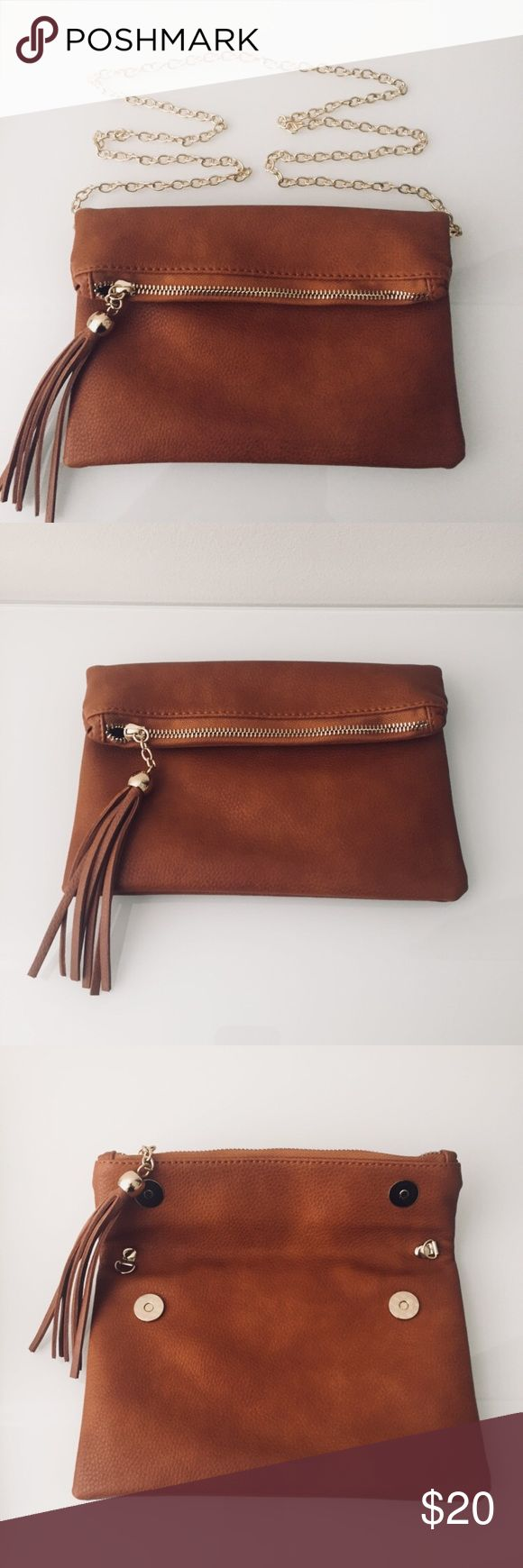 Brown Clutch Great brown clutch purse with gold shoulder strap attachment.  Lots of room and very secure with zipper and fold over design.   Practically brand new, only used once  Stitch Fix accessory Bags Clutches & Wristlets