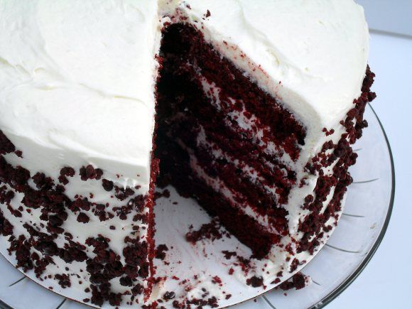 "Red Velvet Cake  I made this for a close friend of mine in return to honest feedback as I could not taste it myself. I received positive feedback from both him and his mom. Both said it was moist and had a great flavor. I put crumbs on the top and on the sides of the cake and when I asked how they liked the crumbs they thought it made the cake taste even better! I used only 1 teaspoon of vanilla in the frosting and only needed 1 ""dome"" of cake crumbs to cover the cake.  I would make this…"