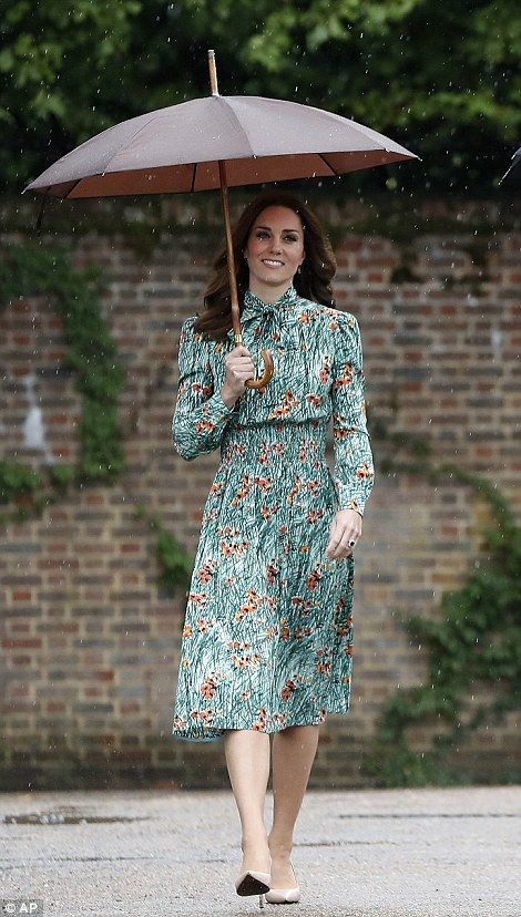 The Duchess, who looked to bein good spirits as she joined her husband and brother-in-law on a private tour of the memorial garden, was dressed in a£ 1,420 printed silk dress from Prada