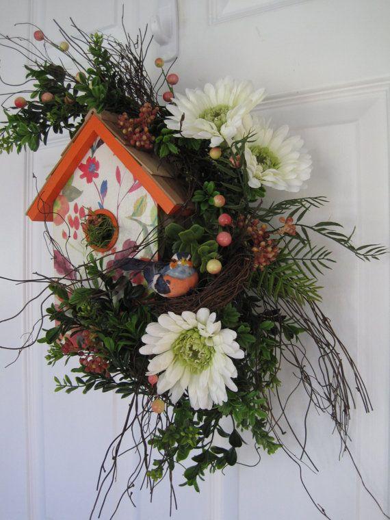 Birdhouse arrangement w/ green and white gerbera dasies, peach berries, bird and birdhouse