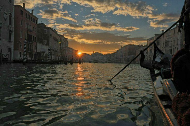 Gondola ride at sunset in venice