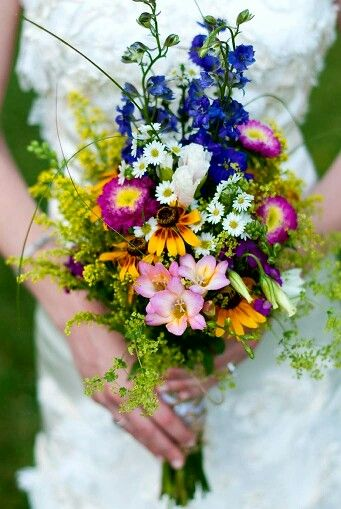 Rustic/Shabby Chic/Boho/Country Wedding Bouquet Showcasing: Blue Delphinium, Fuchsia/Yellow Zinnias, Yellow Sunflowers, Pink Freesia, Purple Stock, Monte Casino Asters, Additional Coordinating Florals, Yellow Solidago & Greenery/Foliage