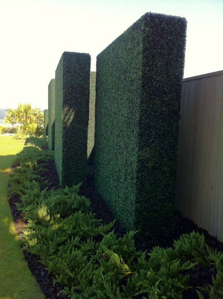 Hedge walls. They're artificial an maintenance-free, but remain every bit as beautiful as natural. What's not to love?