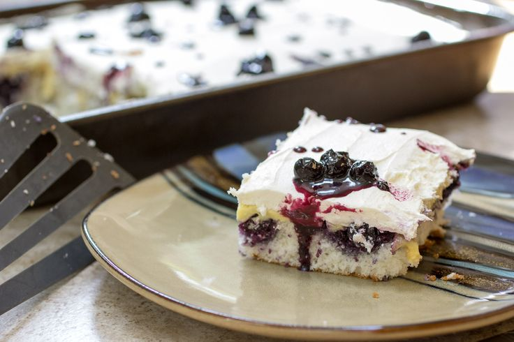 Blueberry Poke Cake with a hint of lemon and iced with a simple white chocolate buttercream.