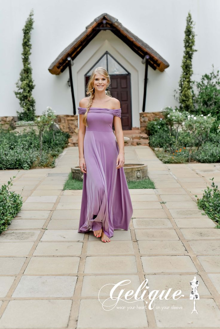 Rebecca Gelique bridesmaids dress. Soft purple dress. Drop sleeve versatile bridesmaids dress.  Available in a variety of sizes and colours from Brides of Somerset. Long, knee-length or short available. Knee length bridesmaids dress.