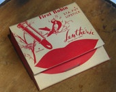 "This Vintage ""matchbook"" contains 6 Lentheric matchstick lipsticks. Three are red and three are clear.    The Matchbook is in very good condition and reads Miracle of Spring, First Robin Stay put Lipstick. The graphics include a red and white robin, red lips and a tube of lipstick. The back reads Miracle perfume by Lentheric and shows a picture of a perfume bottle    http://www.etsy.com/shop/NymphsNecessitys?ref=si_shop"