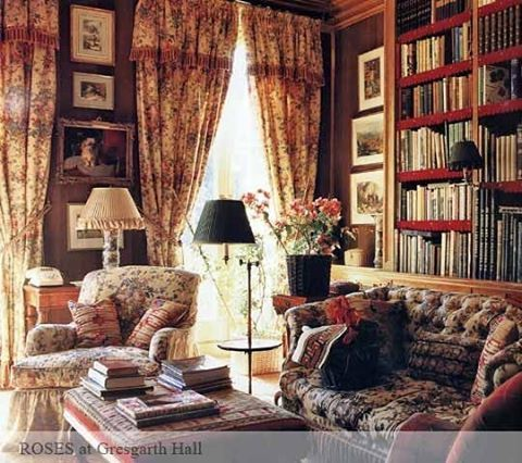 Roses on drapes and furniture, loads of books and flowers make this a very cozy sitting room. Fabrics by Bennison.