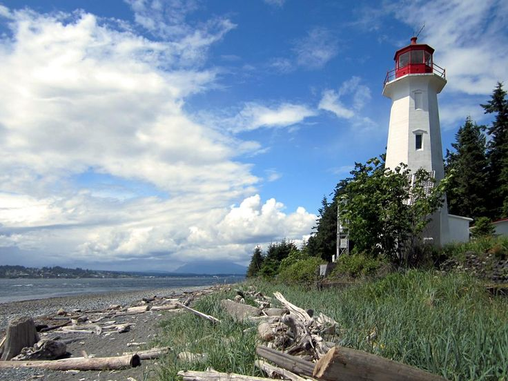 Cape Mudge Lighthouse (1916) on Quadra Island, British Columbia, Canada, overlooks the southern entrance to Discovery Channel.