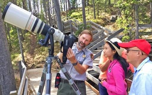 One-time seasonal worker lands dream photo job at Yellowstone In this June 8, 2017 photo, Yellowstone National Park photographer Jim Peaco, left, gives Sunnyvale, Calif., tourists Amanda and Stephen Chou a lesson in shutter speeds while photographing harlequin ducks in the LeHardy Rapids section of the ... #photographyjobsonline