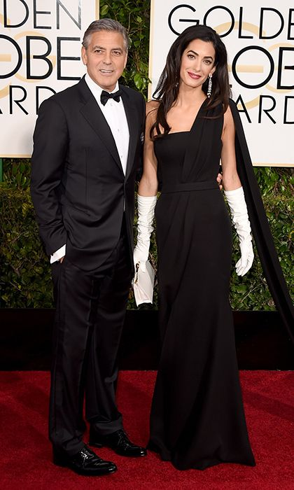 George Clooney and Amal Clooney  The man of the evening, Cecil B. Demille Award-winner George Clooney, may have had his achievement overshadowed by another milestone - his first red-carpet stroll with new wife Amal Clooney, who looked spectacular in a black Dior gown (customized in support of the recent acts of terror in Paris) and her own white opera gloves.  Photo: © Getty Images