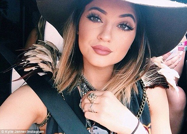 Accessories: Kylie Jenner wore feathers on a shoulders with a dream catcher-like necklace