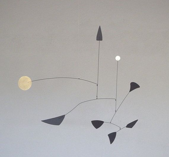This Calder style mobile is constructed in an old school sort of way. I cut the light gauge steel and brass elements with hand tools then assemble