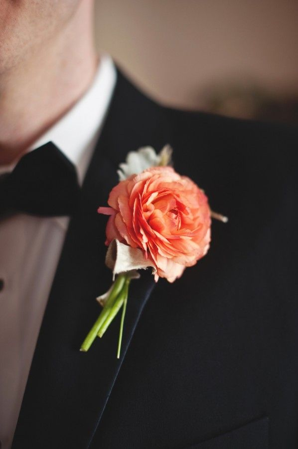 The boutonnieres will be peachy orange ranunculus (no greenery) wrapped in black ribbon with the stems showing.