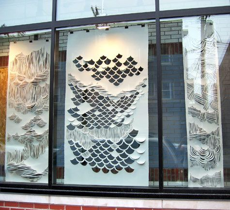 Modern eye-catching paper lasercut window at Urban Outfitters